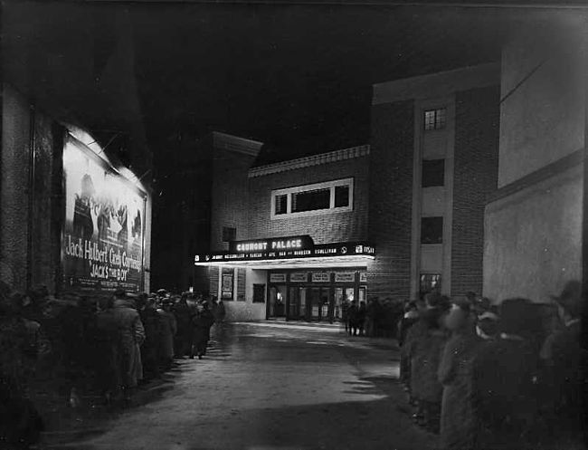 An atmospheric photo of a double queue for the GAUMONT, probably in ...